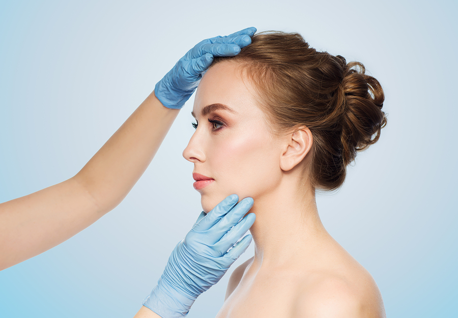 Glove Hands Evaluating a Woman's Face