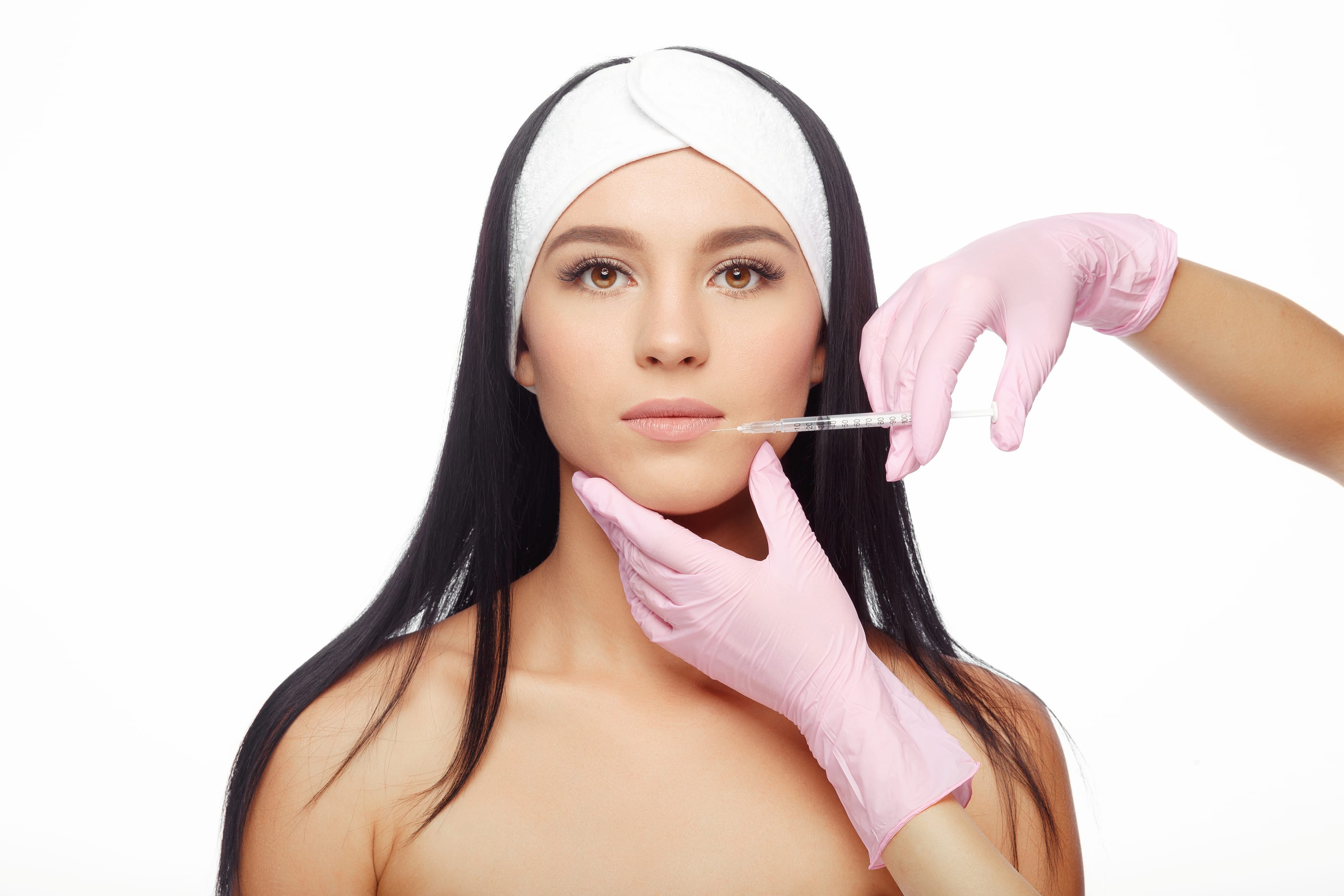 Brunette Receiving Lip Injection By Pink Gloved Hands