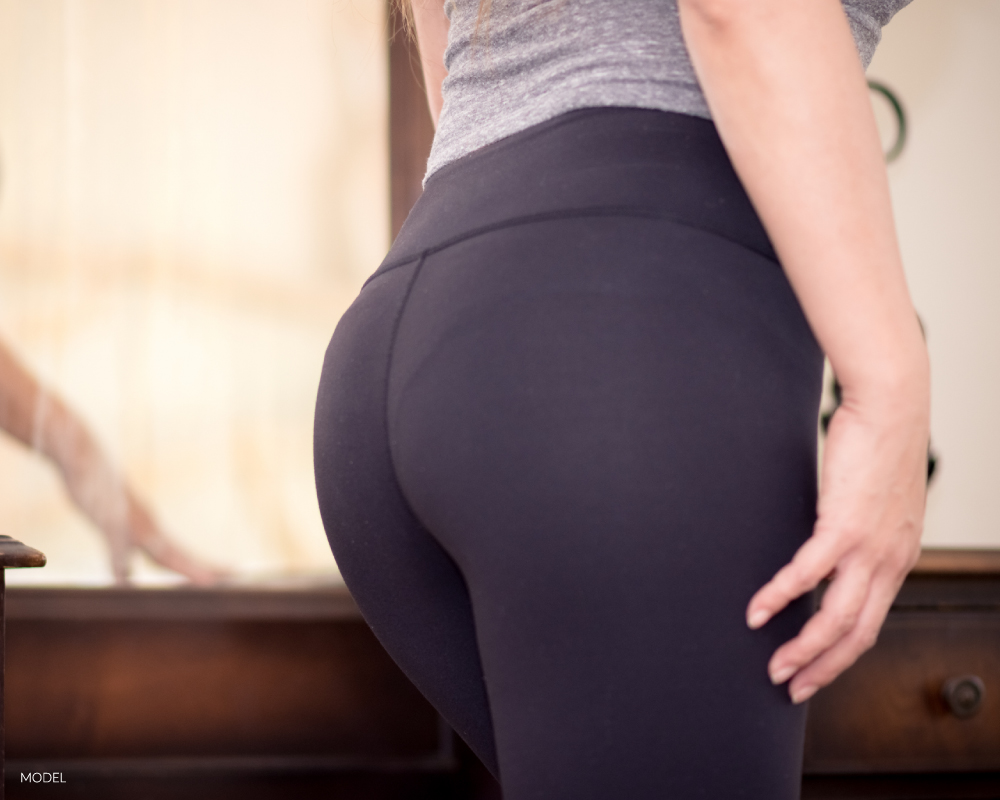 Woman's butt in black leggings