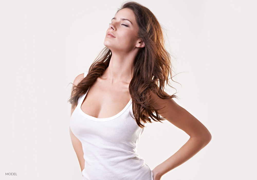 Female Pushing Breasts Forward with Eyes Closed